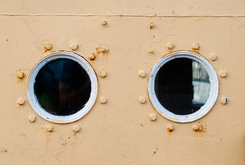Porthole on the  wall of the old ship