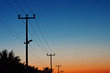 Electric power lines against a dawn sky - 55354077