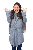 Young pretty model with winter clothes shouting