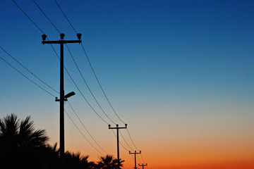 Electric power lines against a dawn sky