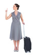 Cheerful gorgeous woman with suitcase pointing her finger up