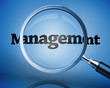 Magnifying glass above the word management