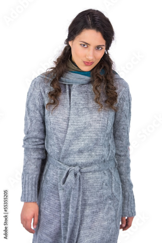 Peaceful curly haired model with winter clothes posing