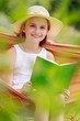 Girl reading a book in the hammock