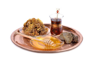 honey on plate ,cup of Turkish tea,propolis