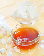 Fresh tea with candy