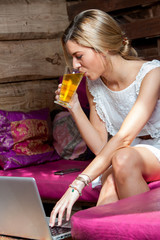 Girl with laptop drinking tea.