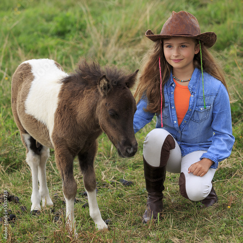 Ranch - Lovely girl with little pony on the ranch