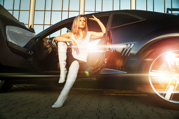 beautiful woman in sport car