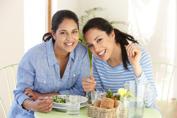Two Women Having Meal In Cafe