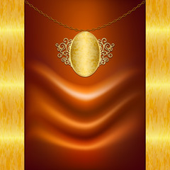 Unusual background with satin fabric and gold pendant