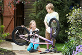 Two Children Cleaning Bike Together