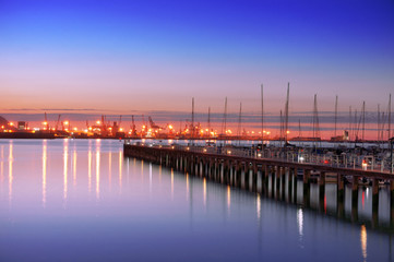 Getxo pier with yacht masts at night