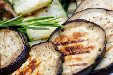 Grilled aubergine with pumpkins, close up