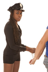Woman cop putting cuffs on another person