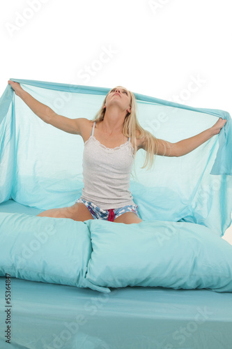 woman in bed hold up sheet