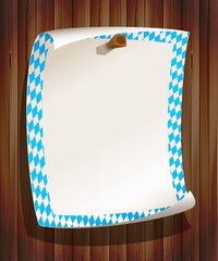 Paper board in bavarian colors on wood background
