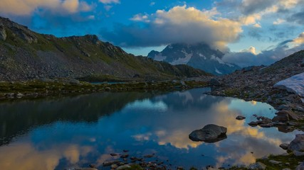 pshish mount reflected in a water at the evening caucasus russia