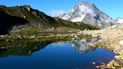 pshish mount reflected in a water caucasus russia