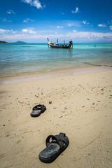 pair of sandal on the beach