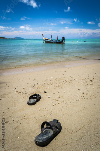 pair of sandal on the beach