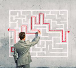 Businessman solving labyrinth problem