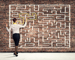 Businesswoman solving maze problem