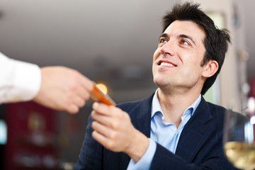 Man paying with credit card at the restaurant