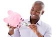Man taking money from a piggybank
