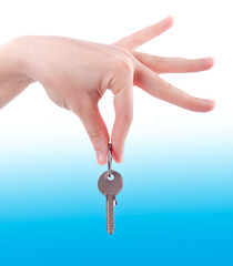 Silver key in a hand.  Hand holding key
