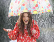 Teenage Girl Sheltering From Rain Beneath Umbrella