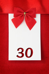 Number thirty on red greeting card