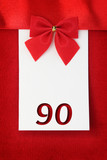 Number ninety on red greeting card