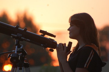 Teen girl and telescope.  Near Kiev,Ukraine