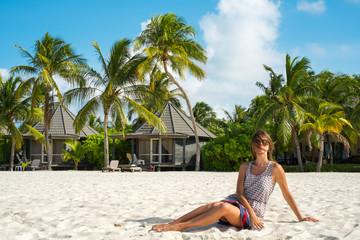 The girl on the white sandy beach (Maldives - Lhaviyani Atoll)