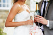 Detail Of Bride And Groom Drinking Champagne At Wedding