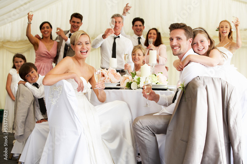 Bride And Groom Celebrating With Guests At Reception - 55377422
