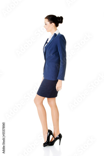 Side view of walking elegant businesswoman