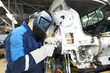 Leinwanddruck Bild - repairman welding metal body car