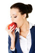 Attractive smiling businesswoman holding red apple