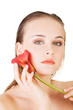 Beauty face of the young beautiful woman with flower.