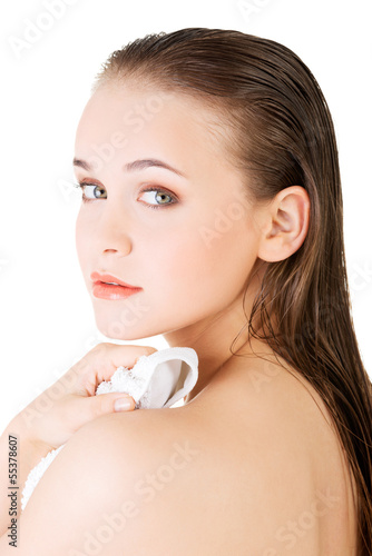 Young beautiful nude woman with towel