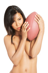 Sexy woman with American football ball