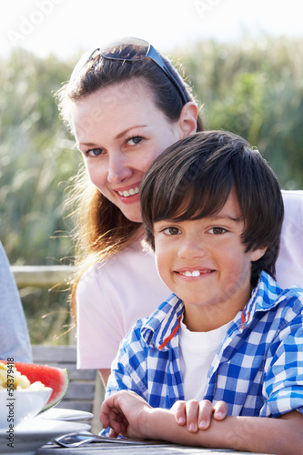 Portrait Of Mother And Son Hugging Outdoors
