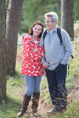 Senior Couple On Country Walk Through Woodland