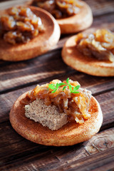Canapes with liver pate and onion confit, selective focus