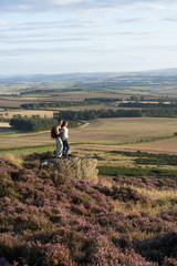 Couple Admiring View On Countryside Walk