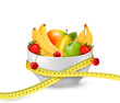 Diet meal. Fruit in a bowl with measuring tape. Concept of diet.