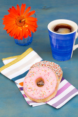 breakfast with black coffee and two donuts