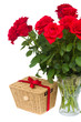 bouquet of scarlet roses in vase with gift basket